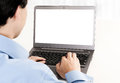Rear view of young man working with laptop computer Royalty Free Stock Image