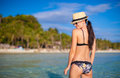 Rear view of young sexy woman in swimsuit and hat the sea this image has attached release Stock Photos