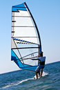Rear view of young windsurfer Stock Images