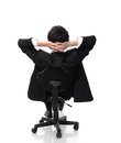Rear viwe of a relaxed businessman with hands behind his head and sit on chair Royalty Free Stock Photography