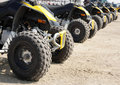 Rear wheel of all-terrain vehicle arranged in row Royalty Free Stock Photo