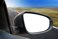 Rearview mirror a closeup of a blank white rear view on a car driving fast on a road there is a zoom effect add your image or text Stock Photography