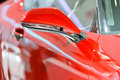 The rearview mirror of a red car Royalty Free Stock Photo