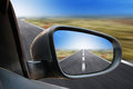 Rearview mirror traveling a closeup of a on a car driving fast on a road there is a zoom effect Royalty Free Stock Photo