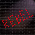 Rebel concept illustration depicting grafitti on a wall with a Stock Image