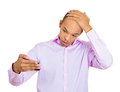 Receding hairline closeup portrait shocked man feeling head surprised he is losing hair or seeing bad news on cellphone isolated Royalty Free Stock Photo
