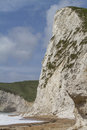 Recent cliff rockfall durdle door dorset uk rock fall from a chalk onto the beach below at part of the world heritage jurassic Stock Image