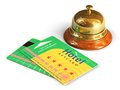 Reception bell and hotel cardkeys travel tourism concept golden group of color keycards or on white background Royalty Free Stock Image