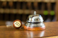 Reception - Hotel bell and key lying on the desk Royalty Free Stock Photo