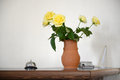 Reception the at the hotel call a vase of yellow roses flowers Royalty Free Stock Image