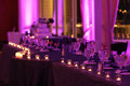 Reception time the head table is back lit and set up in anticipation of the beginning of a wedding Stock Photography