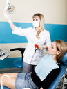 The reception was at the female dentist. Doctor examines the oral cavity on tooth decay. Caries protection. doctor puts