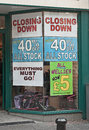 Recession continues another shop closing with reductions of a sign that the is not over for some businesses Royalty Free Stock Photo