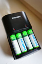 Rechargeable batteries poznan poland january philips in charger Stock Images