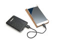 Recharging smart phone tablet from power bank isolate Stock Photography