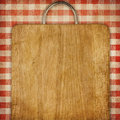 Recipe background breadboard over red gingham picnic tablecoth hardboard or checked tablecloth grunge Stock Photography