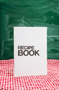 Recipe book on a kitchen table Royalty Free Stock Photography