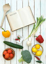 Recipe book open blank surrounded by fresh ingredients Royalty Free Stock Photos