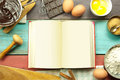 Recipe book open blank surrounded with ingredients Royalty Free Stock Photo