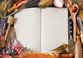 Recipe book open surrounded of food ingredients and kitchen utensils Stock Photo