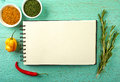 Recipe book and spices on blue wooden background Royalty Free Stock Photos