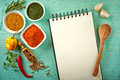 Recipe book and various spices on blue wooden background Royalty Free Stock Photos
