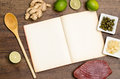 Recipe book with wooden spoon and text space ingredients Stock Photos