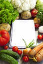 Recipe notebook and fresh vegetable healthy vegetables placed all around a for recipes Stock Images