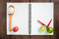 Recipe notebook, tomatoes, Red chilli, garlic and lemon on woode Royalty Free Stock Photo