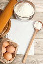 Recipe paper and baking cake ingredients on a wooden table Royalty Free Stock Photos