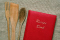 Recipe red book of recipes with wooden cutlery Royalty Free Stock Photo