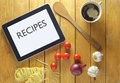 Recipes on a tablet with heading table surrounded by fresh food ingredients Royalty Free Stock Photo
