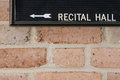 Recital hall sign on brick wall Stock Photography