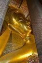 Reclining buddha gold statue face wat pho bangkok thailand Stock Images
