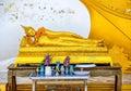 Reclining buddha golden in bangkok thailand Stock Photo
