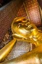 Reclining buddha golden bangkok thailand Stock Image