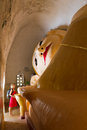 Reclining buddha at manuha paya in bagan burma giant with tourist woman Royalty Free Stock Images