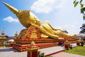 Reclining Buddha Statue at Wat Pha That Luang, Vientiane, Laos Royalty Free Stock Photo