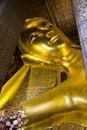 Reclining buddha at wat pho image of gold bangkok thailand Royalty Free Stock Photo