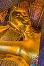 Reclining buddha wat pho temple bangkok thailand portrait at Stock Photography