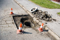 Reconstruction hole three repair cones around in roadway Stock Images