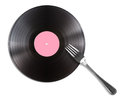 Record disc and fork isolated on white Royalty Free Stock Photography