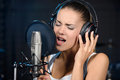 Recording studio portrait of young woman a song in a professional Stock Image