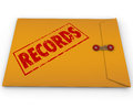 Records documents yellow confidential document a envelope with red stamp and the word to illustrate secret or information such as Stock Photos