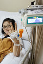Recover patient smiling and pose to camera focus on the hand Stock Photo
