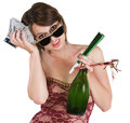 Recovering party girl young woman with favors and ice pack on head Royalty Free Stock Photo
