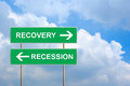 Recovery and recession on green road sign with blue sky Stock Photo