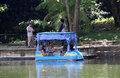 Recreation people are enjoying with boats on the pond a city park in the city of solo central java indonesia Royalty Free Stock Photos