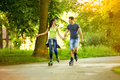 Recreation on rollerblades young couple having Royalty Free Stock Image