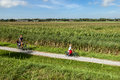 Recreational bicycling in the fields family on vacation on island schiermonnikoog netherlands Stock Images